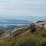 Hikers who reach the top of Cadillac Mountain in Acadia National Park are rewarded with a spectacular view of the Maine coastline and Frenchman Bay. The pink granite summit is one of the first places in the country to see the sunrise. Acadia is the oldest national park east of the Mississippi. (Photo by Jerry Ondash)