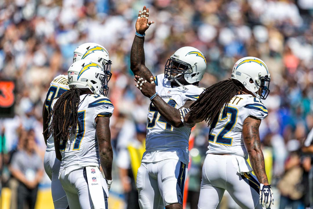 Los Angeles Chargers outside linebacker Melvin Ingram (54) celebrates a sack of Jacksonville Jaguars quarterback Blake Bortles. Photo by Bill Reilly