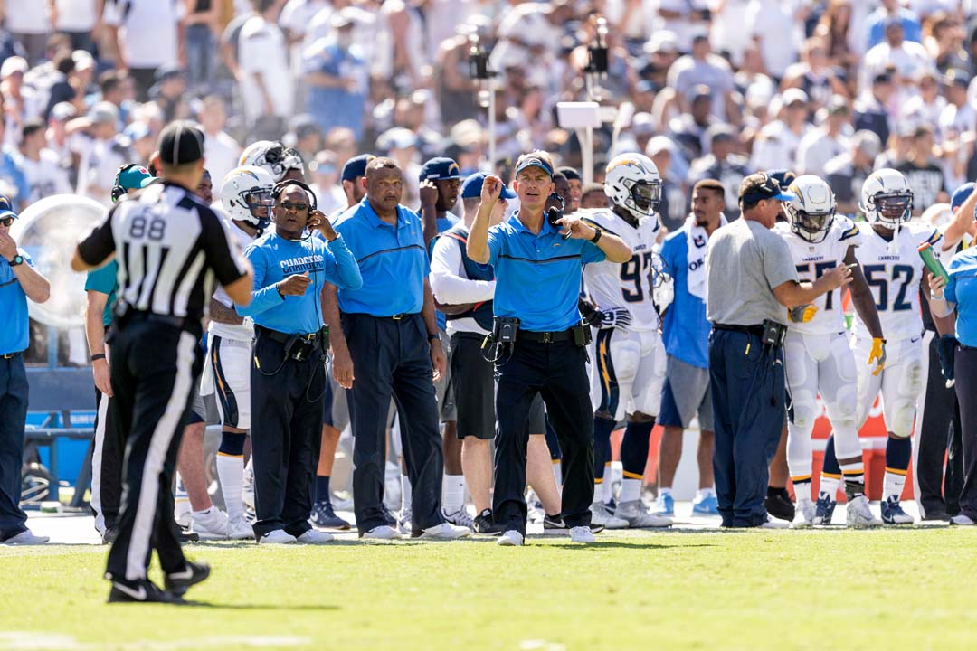 San Diego Chargers head coach Mike McCoy motions to one of the officials. Photo by Bill Reilly