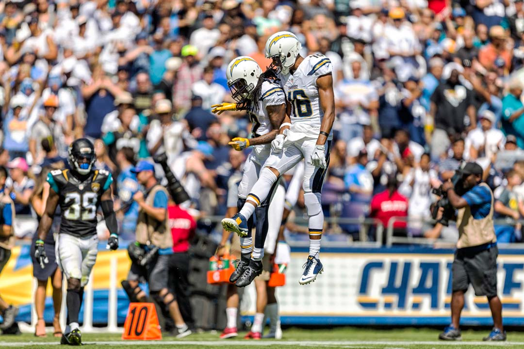 San Diego Chargers wide receiver Travis Benjamin (12) and Tyrell Williams (16) celebrate a catch for a first down and goal to go during Sunday's home opener. Photo by Bill Reilly