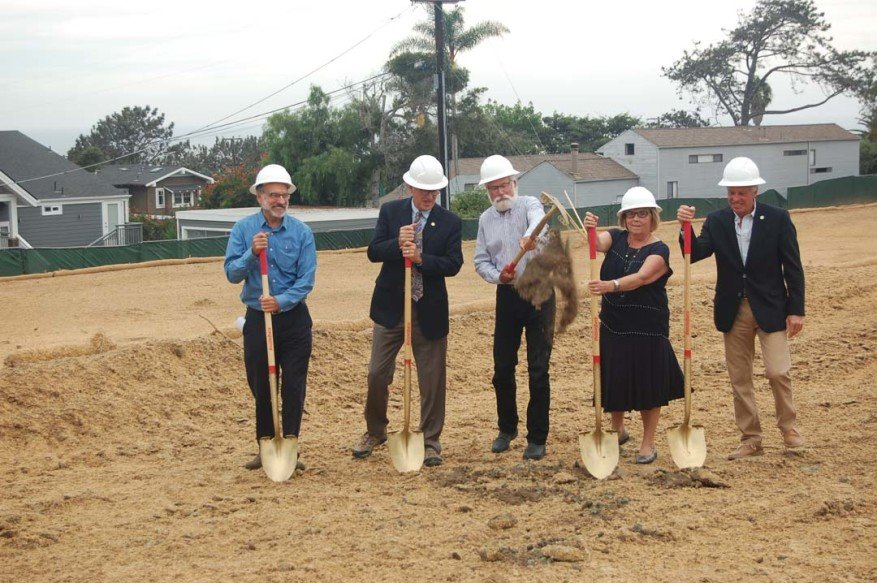 On the former site of City Hall, which was demolished beginning in June, Councilmen Dwight Worden, Terry Sinnott and Don Mosier, Mayor Sherryl Parks and Councilman Al Corti participate in a Sept. 19 groundbreaking for the civic center complex. Photo by Bianca Kaplanek