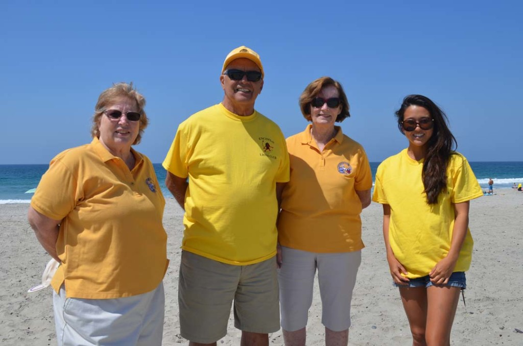 From left: Encinitas Lions Club members Rinkie Pollack, Bob Mangini, Sandy Mangini and Saya Nodera, operations manager with Urban Surf 4 Kids. The 21st annual blind surfing event is Sept. 11 at South Ponto State Beach. Photo by Tony Cagala