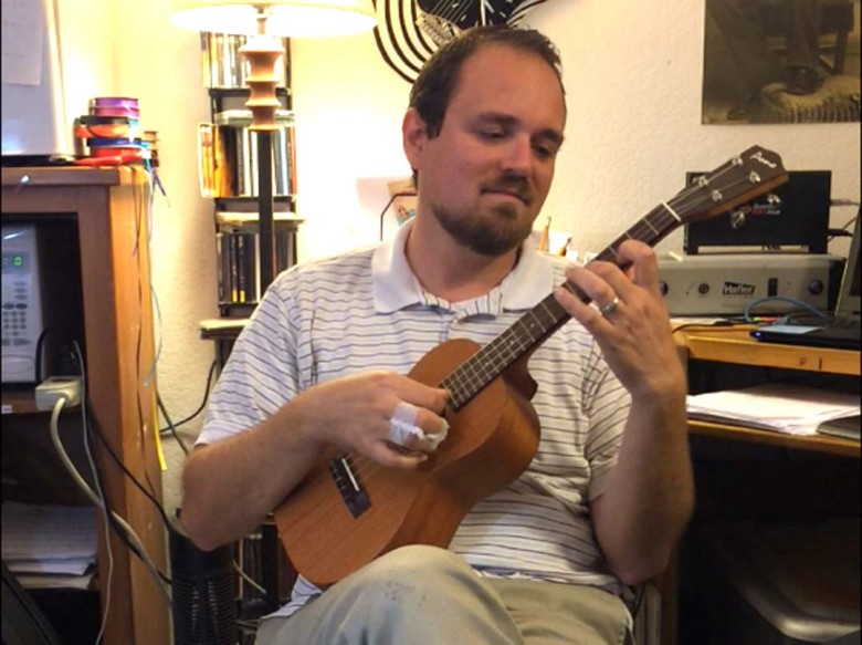 William Wilson, the assistant director of the Encinitas Guitar Orchestra, is recording an album of Flamenco music on the ukulele. Photo by Aaron Burgin