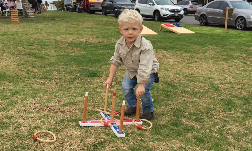 A youngster plays on the Village Green during a previous Village Vibe event. The pop-up events were scaled back due to zoning requirements. File photo by Christina Macone-Greene
