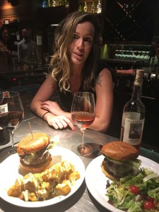 Solterra server/bartender extraordinaire Gabriela Fazan presenting their fabulous Navarra Lamb and Niman Ranch beef burgers. Photo by David Boylan