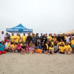 Participants, coaches and catchers pose for a group photo during the Encinitas Lions Club's 21st annual blind surf event held last Sunday at South Carlsbad State Beach. Photo by Pat Cubel