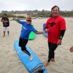 Penny Mayor, a resident of San Diego, strikes a pose as she prepares to take to the waves. Photo by Pat Cubel