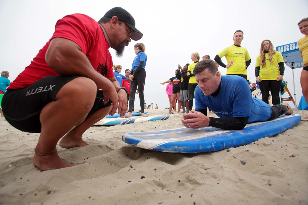 Chris Sommers gets some instruction form his coach as he prepares to ride the waves for the first time during the Encinitas Lions Club's 21st Annual Blind Surf Event held last Sunday at South Carlsbad State Beach.