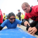 Frances Chavez gets some instruction from her coach as she prepares to ride the waves during. Photo by Pat Cubel