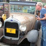 David Brennan of Whittier, Calif., stops to admire an un-restored 1947 Ford woodie.