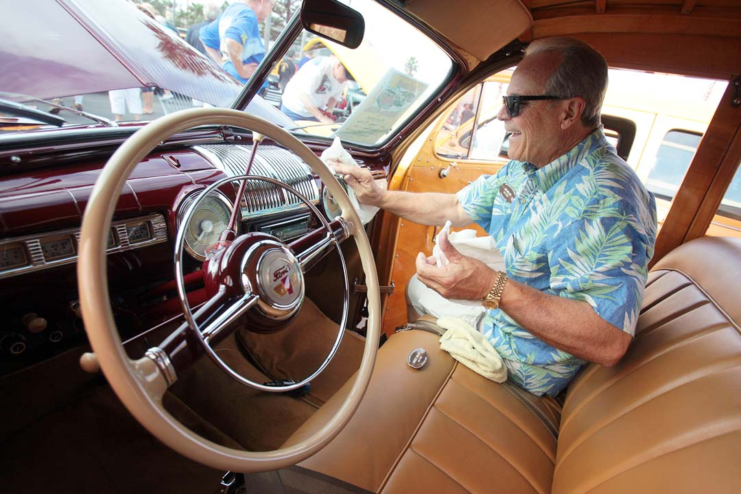 Woodie owner Jim Miller of Redondo Beach puts the finishing touches on the interior of his show car.