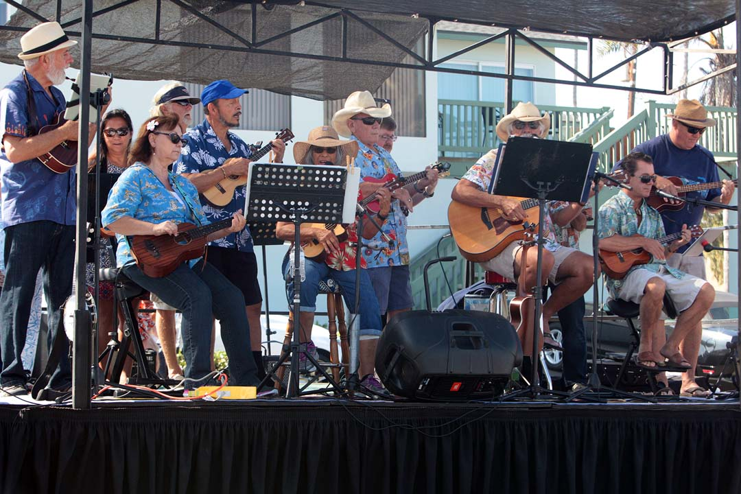 The Moonlight Beach Uke and Drummer Band perform throughout the day.