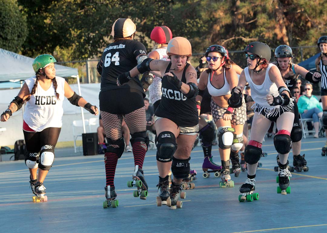 The Knockouts Commando Quirks bolts past the Sugar Ray blockers to score 4 points in roller derby action last Saturday at Oceanside's MLK Park.