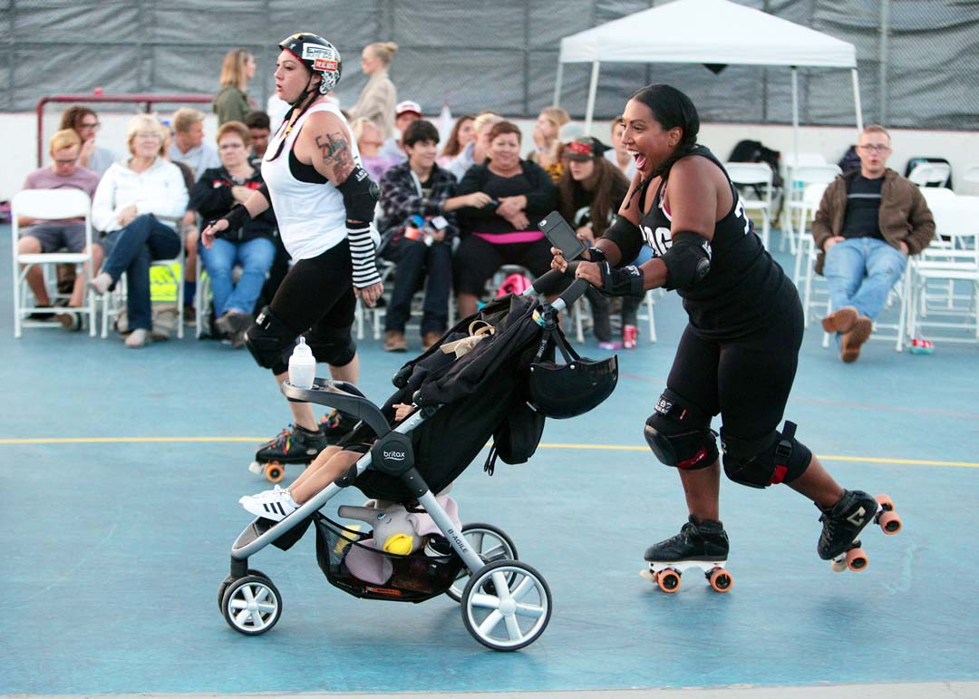 Beachside Bullies, Coo Coo for CoCo warms up with her baby prior to the teams match against the San Diego Cuttlefish. The Hidden City Roller Girls League hosted a double header match up last Saturday at Oceanside's MLK Park.