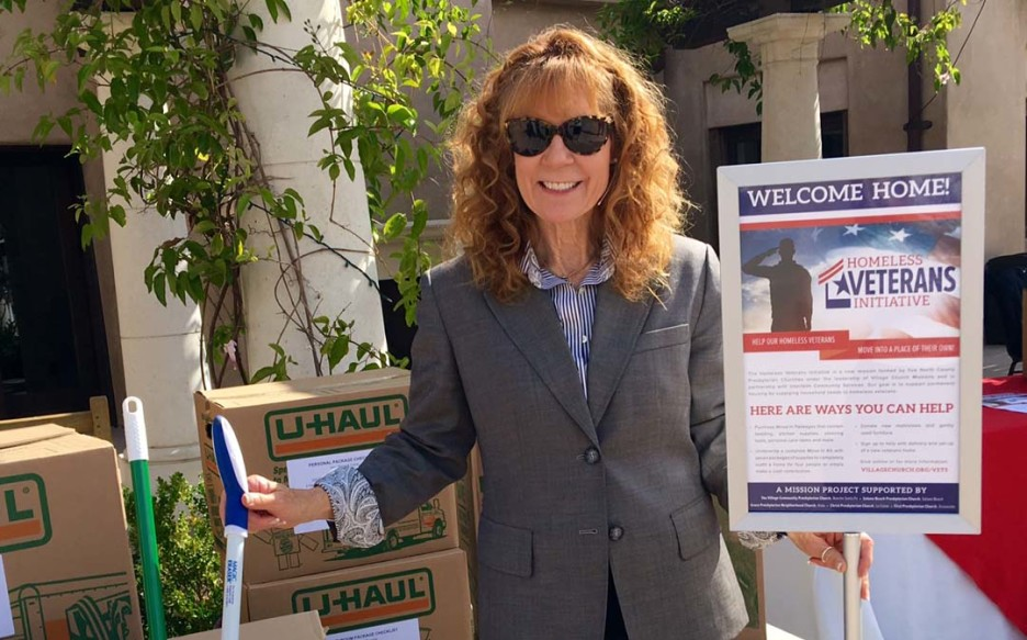 Reverend Dr. Jan Farley collects items for homeless veterans on Sept. 11 at the Village Church in Rancho Santa Fe. Farley explained that the collected items will be transferred to Interfaith Community Services where they will be stored and then distributed to the veterans.  Courtesy photo