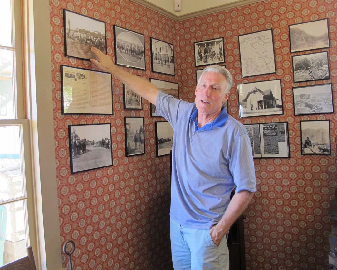 Richard Beck, co-owner of the historic Hotel Temecula, has collected many photos of the hotel and the town of Temecula. He uses them to help illustrate the history of the hotel when he welcomes guests.  Photo by Laurie Brindle