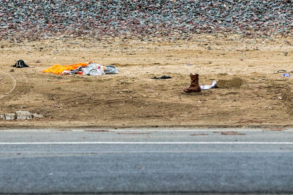 The clothes of Joseph Ramos, 35, a known gang member and residential burglary suspect, lies on the ground in the area where he was treated for injuries sustained during an officer involved shooting that took place on North Coast Highway 101 in Leucadia. Photo by Bill Reilly