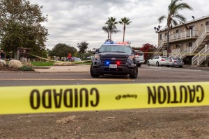 San Diego County Sheriff's deputies block off North Vulcan Avenue because of an officer involved shooting. Photo by Bill Reilly