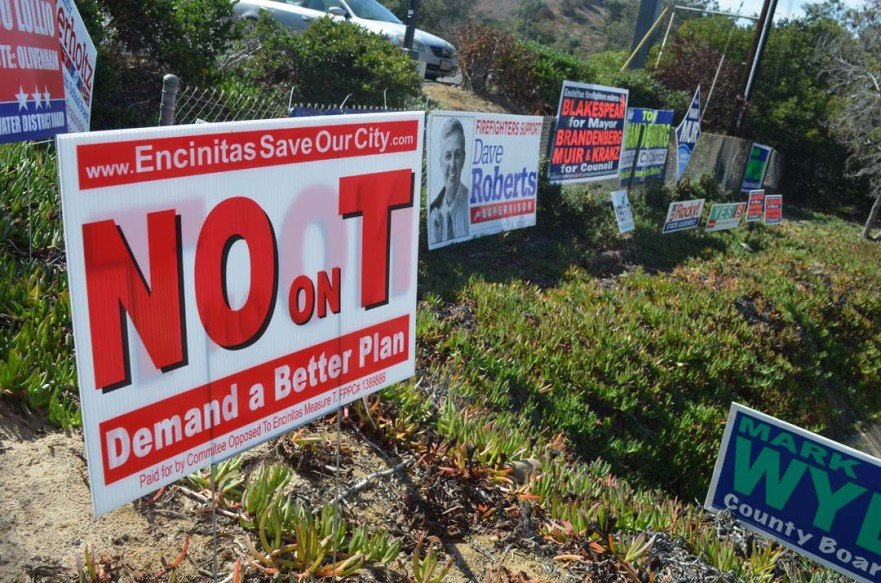 Political Action Committees are pumping money into the Encinitas City Council and Measure T races. One group, the Committee Opposed to Encinitas Measure T, raised $7,218 and spent close to $4,500 on signs and mailers. Photo by Tony Cagala