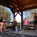 A youngster enjoys some bluegrass music. Photo by Tony Cagala