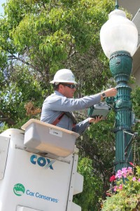 Cox technician Gene Farris installs Cox Wi-Fi hotspots.  Courtesy photo