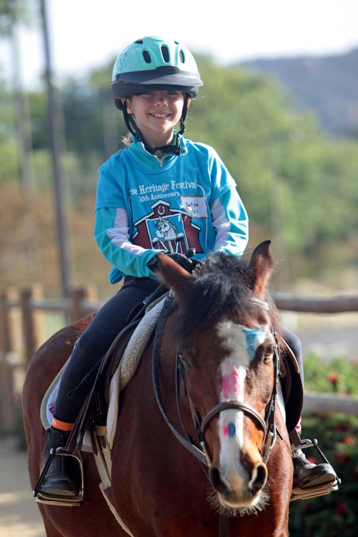 A young participant is enjoying their morning ride at the Horse Heritage Festival at San Marcos' Heritage Park and the Walnut Grove Park. Photo by Pat Cubel