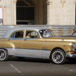 "This 1951 Pontiac is one of the better maintained vintage cars in Cuba. Cubans keep these cars in running condition not out of love, but because there are no alternatives, say the authors of ""Cuba's Car Culture."" Because official Cuban-American relations are improving and the number of American visitors is already ballooning, Cubans are working hard to upgrade their 60-year-old cars. (Photo by Bill Warner)"