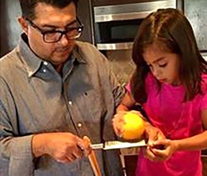 Ari Vega, a 6-year-old first grader at Skyline Elementary, and her dad, Art, prepare pork chops stuffed with cranberry rice as part of a contest to win a $30,000 cafeteria makeover for her school. Courtesy photo