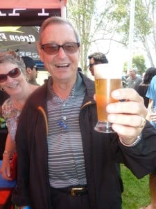 The beer king of the Encinitas Oktoberfest, Edgar Engert, with his wife Renate, admire an Alpine Beer, a German style brew from Alpine, in east San Diego County. Photo by Frank Mangio