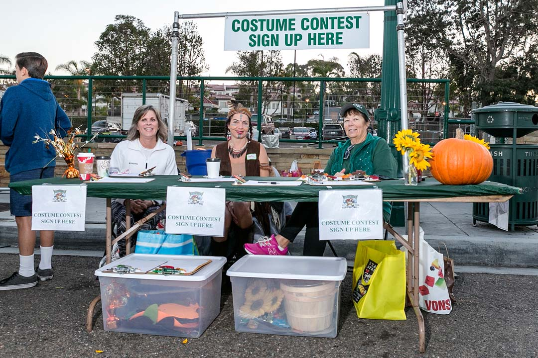 From left: Lauren Garver, Melissa Cerborino and Kathy Stantor are waiting to support race participants who want to sign up for the costume contest at the Encinitas Turkey Trot and Food Drive held on Thanksgiving day. Photo by Bill Reilly