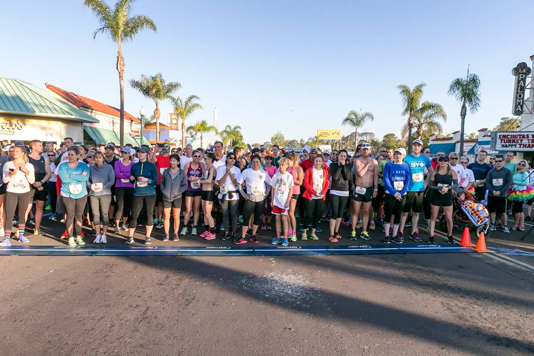 Encinitas Turkey Trot and Food Drive race participants gather at the starting line before the 10k race on Thanksgiving Day. Photo by Bill Reilly