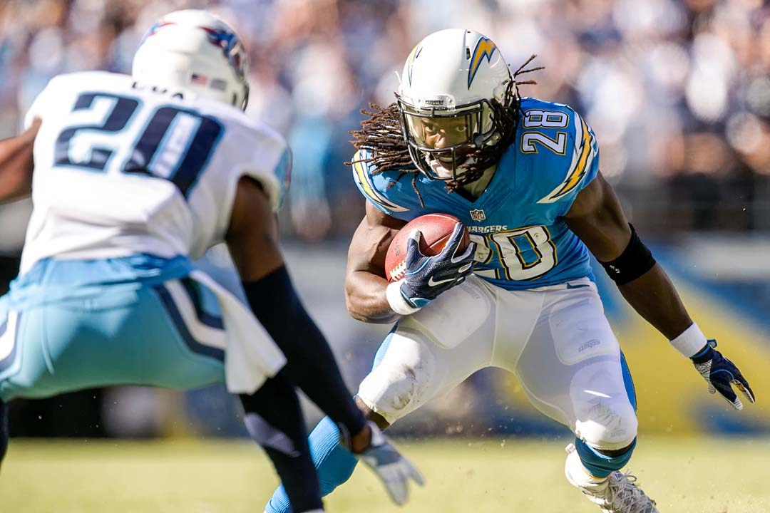 San Diego Chargers running back Melvin Gordon (28) escapes a tackle attempt from Tennessee Titans cornerback Perrish Cox (20). Photo by Bill Reilly