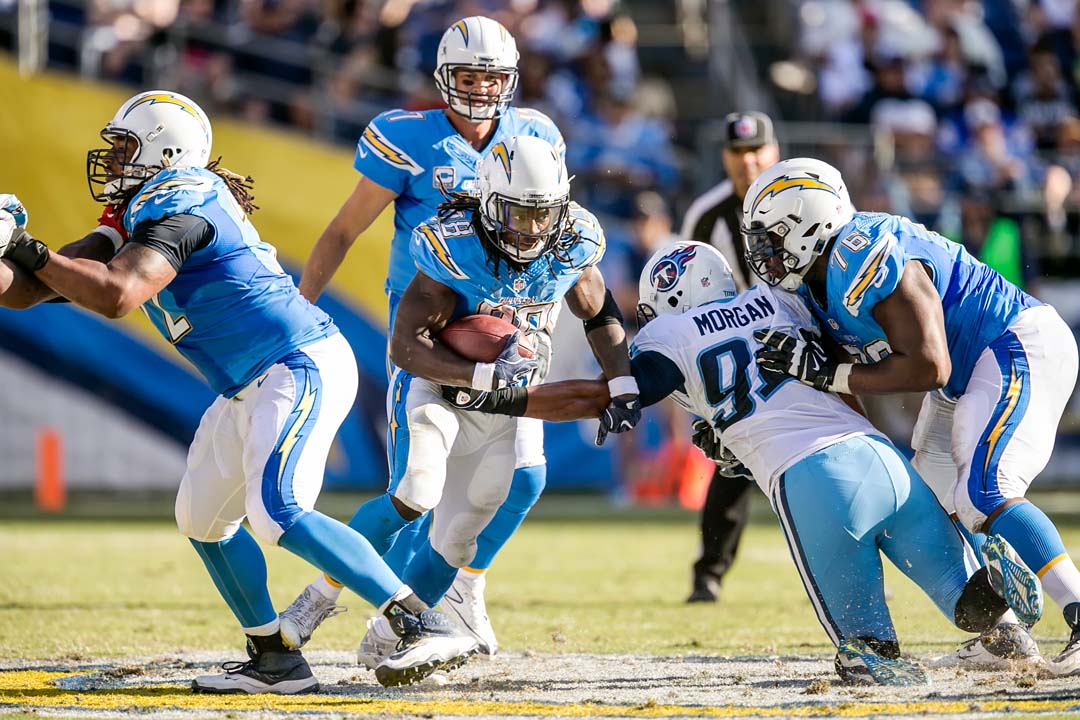 San Diego Chargers running back Melvin Gordon (28) runs the ball against the Tennessee Titans defense as quarterback Philip Rivers (17) looks on. Gordon ran for a career high 196 yards. Photo by Bill Reilly