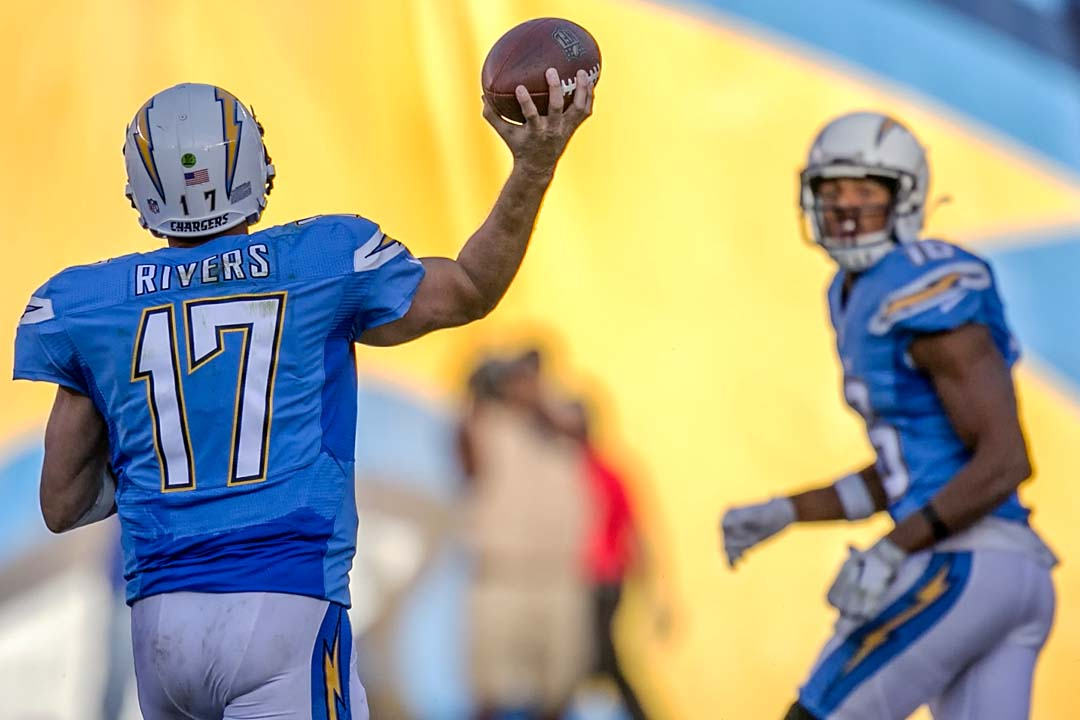 San Diego Chargers quarterback Philip Rivers (17) throws a pass downfield to wide receiver Tyrell Williams (16). Photo by Bill Reilly