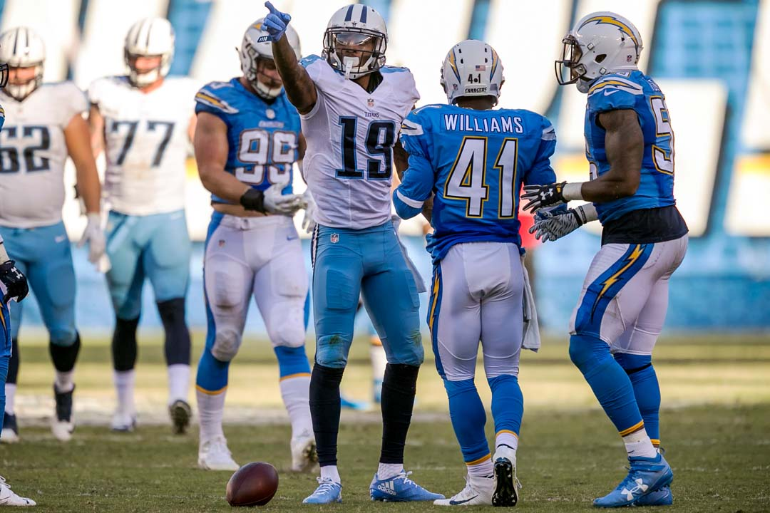 Tennessee Titans wide receiver Tajae Sharpe (19) signals a first down in front of the San Diego Chargers defense. Photo by Bill Reilly