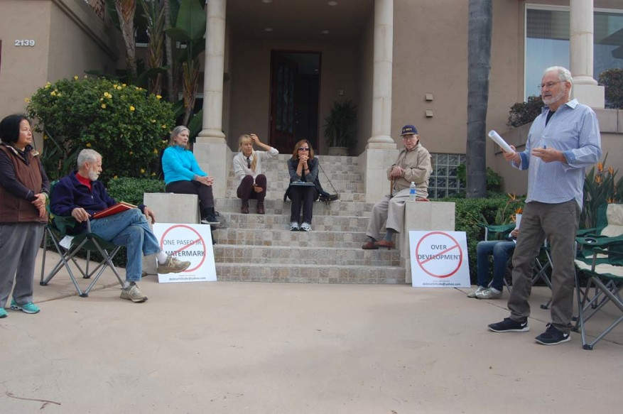 Arnold Wiesel, far right, holds a neighborhood meeting earlier this year in front of his house to share his plans about Measure R, a failed initiative in the Nov. 8 election that would have allowed residents to vote on certain large developments.  File photo by Bianca Kaplanek