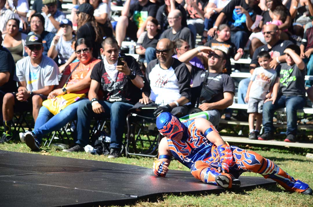 Aerostar feels the pain after his opponent Drago throws him out of the wrestling ring. Photo by Tony Cagala