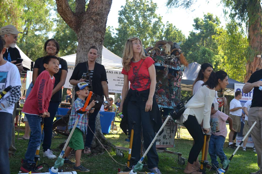 Youngsters launch paper rockets at the Maker Faire San Diego booth. Photo by Tony Cagala