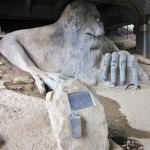 "This 18-foot-tall concrete monster known as the Fremont Troll resides under the Aurora Bridge in Seattle (North 36th Street and Troll Avenue North). He was born in 1990 after a call to local artists to ""enhance the underpass."" The sculpture includes a real VW Beetle which eventually had to be filled in with concrete after it was vandalized. (Photo by Moonspenders)"