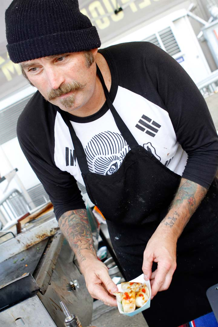 Tyler Mars, owner and chef at Moon Age Foods, prepares some delicacies. Photo by Pat Cubel
