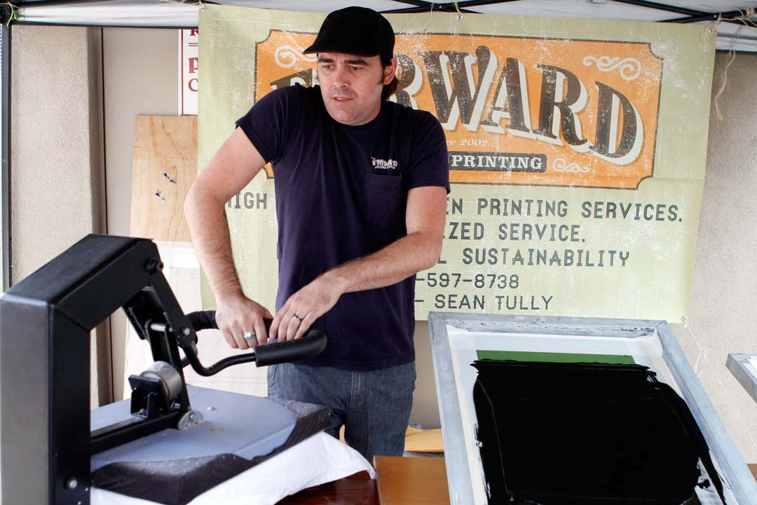 Sean Tully, owner and operator of Forward Printing in Vista, offers free screen-printings. Photo by Pat Cubel
