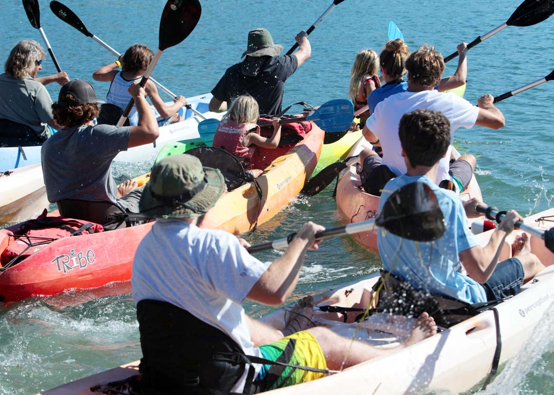 Relay race competitors at the 2nd Annual Rubber Ducky Regatta hosted by California Water Sports at the Agua Hedionda Lagoon in Carlsbad paddle for position during the relay race last Saturday afternoon. Photo by Pat Cubel