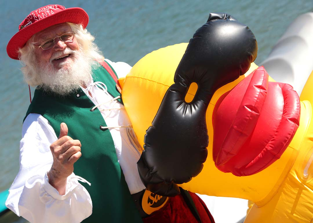 It must be Holiday time as Sustainable Santa helped host the 2nd annual Rubber Ducky Regatta last Saturday att Carlsbad's Agua Hedionda Lagoon. Photo by Pat Cubel