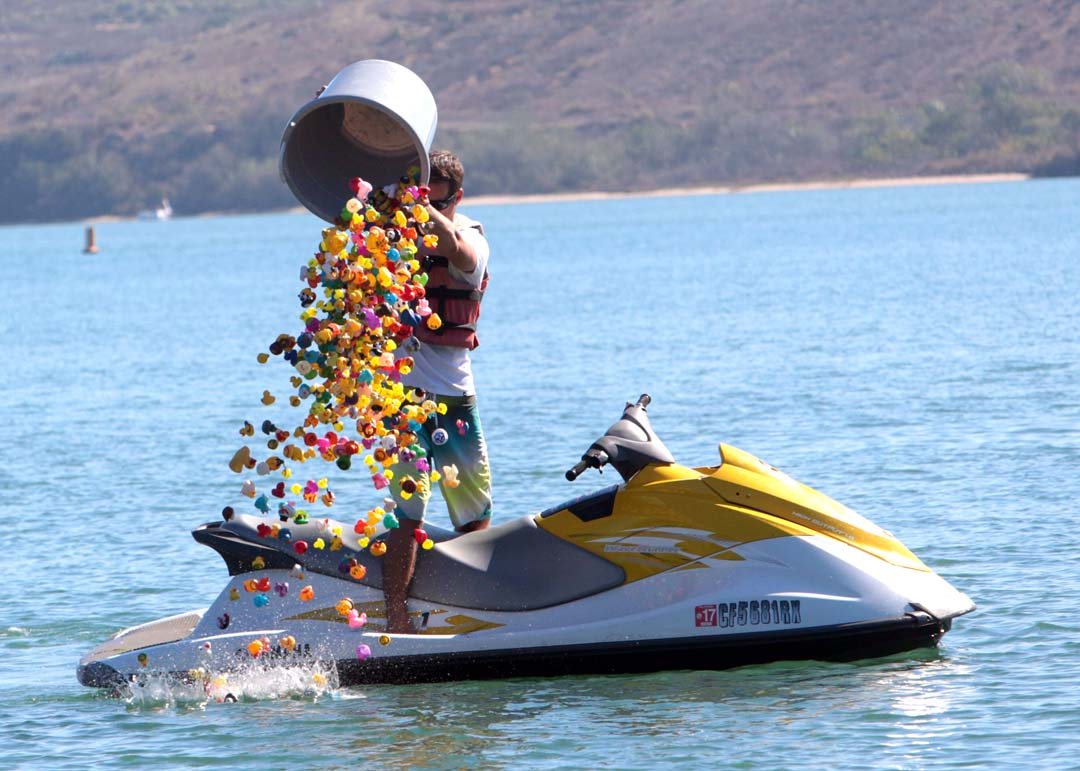 Josh Cantor, owner of California Water Sports and host to the second annual Rubber Ducky Regatta drops the entries in to the lagoon. The event promotes and educates locals on the activities and life cycles of the Agua Hedionda Lagoon as well the dangers that it faces. Photo by Pat Cubel