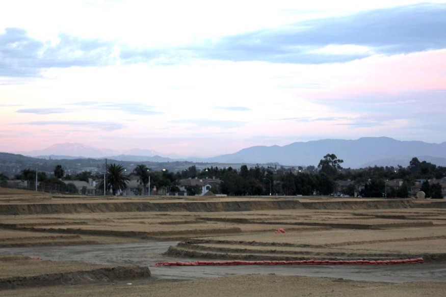 Grading is underway on the Villa Storia housing project site in Oceanside. It's expected that affordable housing units will be ready to move in by next fall. Photo by Promise Yee