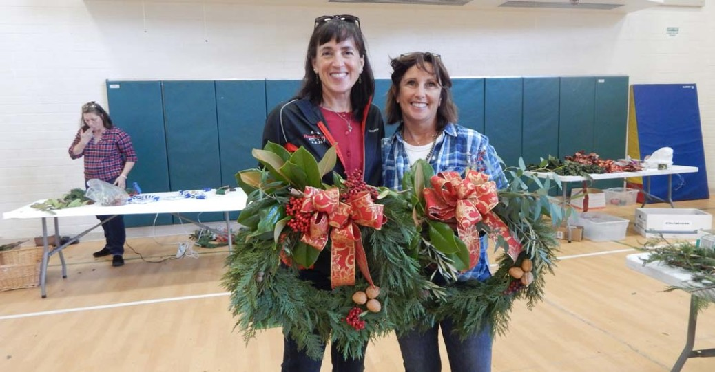 Anne Rogers and Anne Vuylsteke with their handmade wreaths at the Rancho Santa Fe Garden Club's annual wreath-making event on Dec. 8. Photo by Christina Macone-Greene