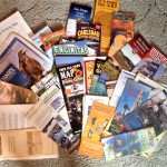 An accumulation of brochures from over the years illustrates just how many things there are to see and do in San Diego County.