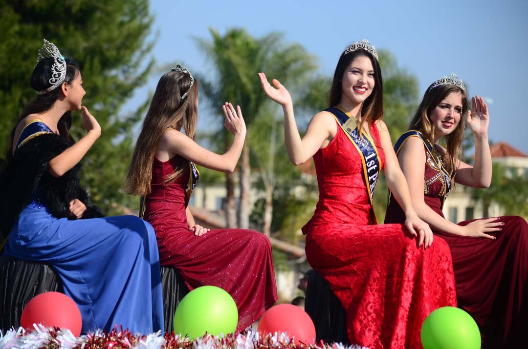 Hanna Nelson, second from right, Miss Teen Poway's 1st princess, rides on a float with other Miss Poways. Photo by Tony Cagala