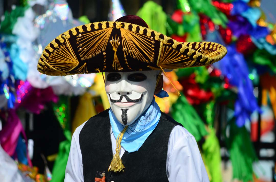 """A dancer in mask performs """"La Danza del Torito,"""" at the Multicultural Holiday Festival in Grape Day Park. Photo by Tony Cagala"""