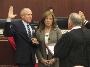 Councilman Mike Morasco takes the oath surrounded by his wife during the swearing in ceremony on Wednesday. Photo by Steve Puterski
